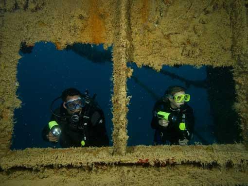 PADI Deep Diver Specialty Course Students exploring a wreck
