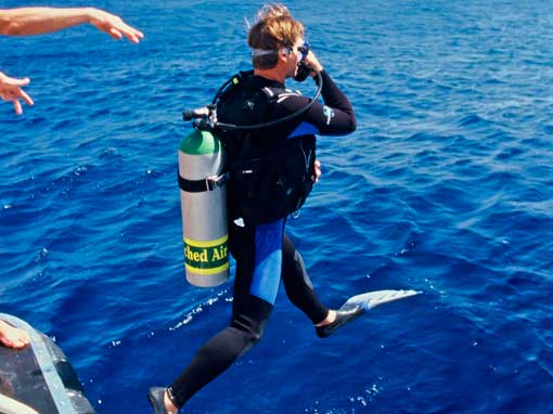 PADI Enriched Air Nitrox Specialty Course Student entering the water