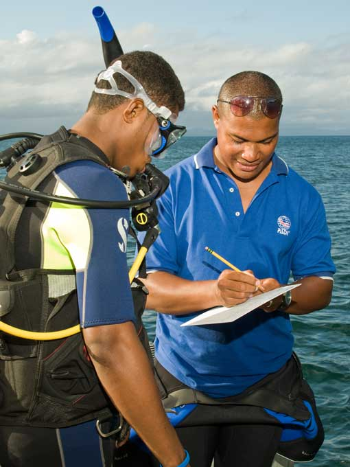 PADI Instructor Candidate receiving feedback from PADI Course Director