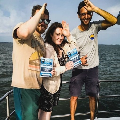 Divers receiving their Shark Guardian Diver Certificates of Completion